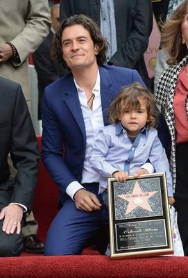 Орландо Блум с сыном от Миранды Керр