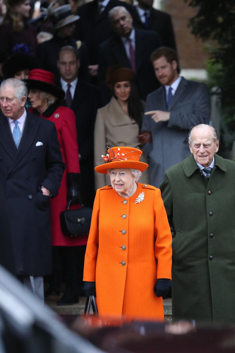 Королева Елизавета II, принц Филипп, принц Гарри, Меган Маркл и другие члены королевской семьи