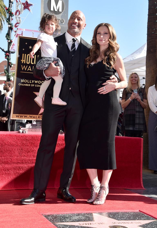Дуэйн Джонсон с Лорен Хэшиан и дочерью Жасмин